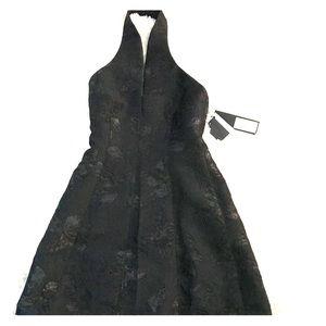 Halston black halter dress NWT 0 backless